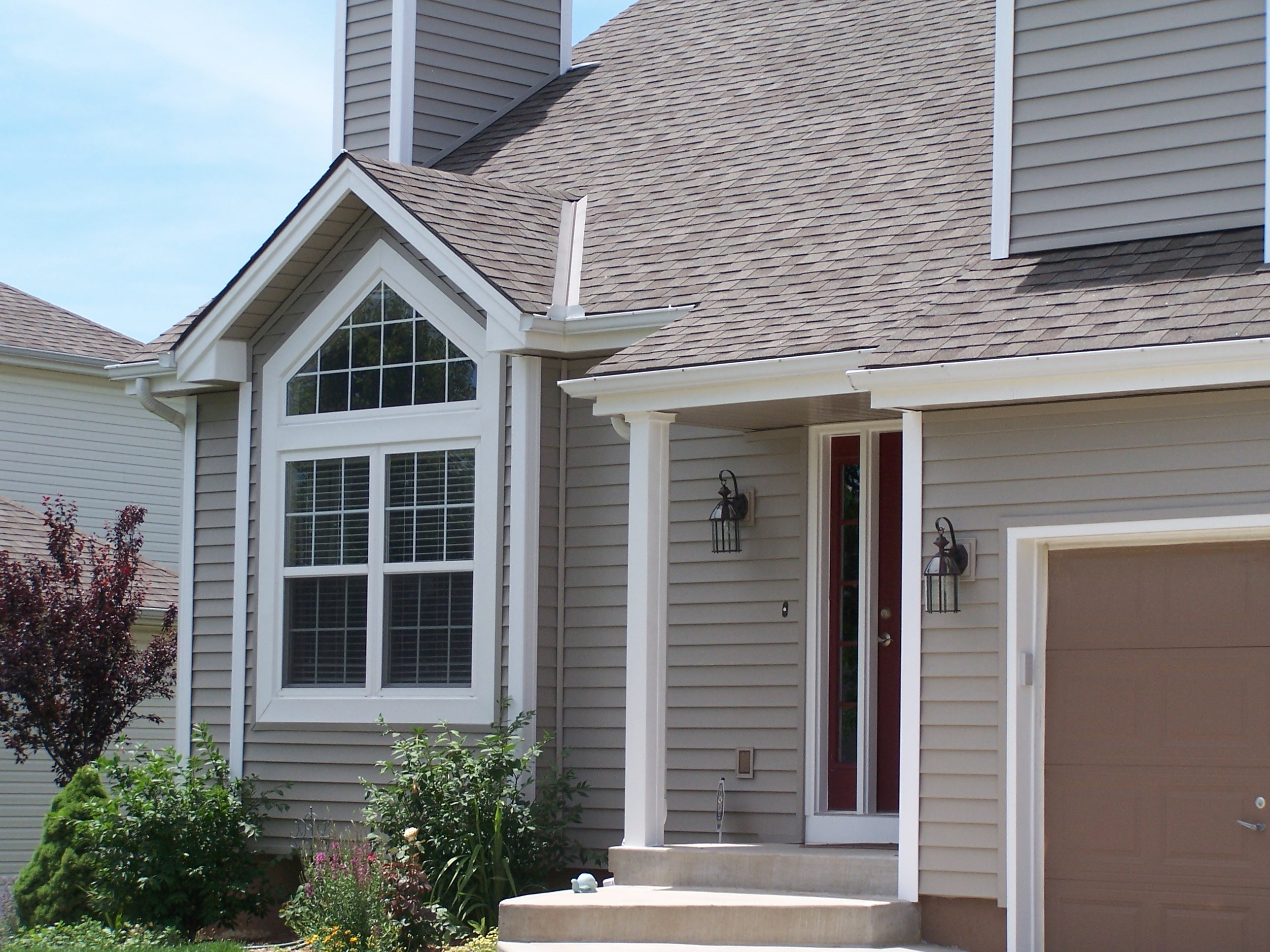 Vinyl stone siding for Blue siding house